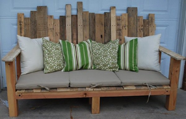 wood pallet outdoor bench with green cushions