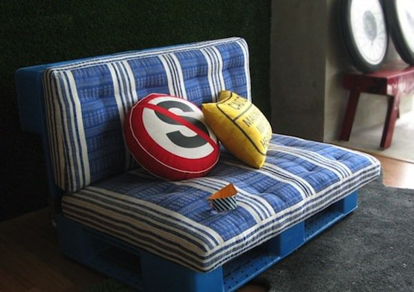 blue mini pallet sofa with white stripes and red and yellow cushions