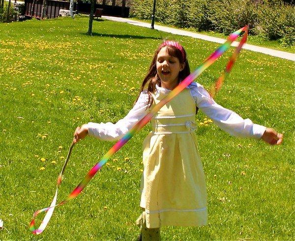 girl twirling ribbons