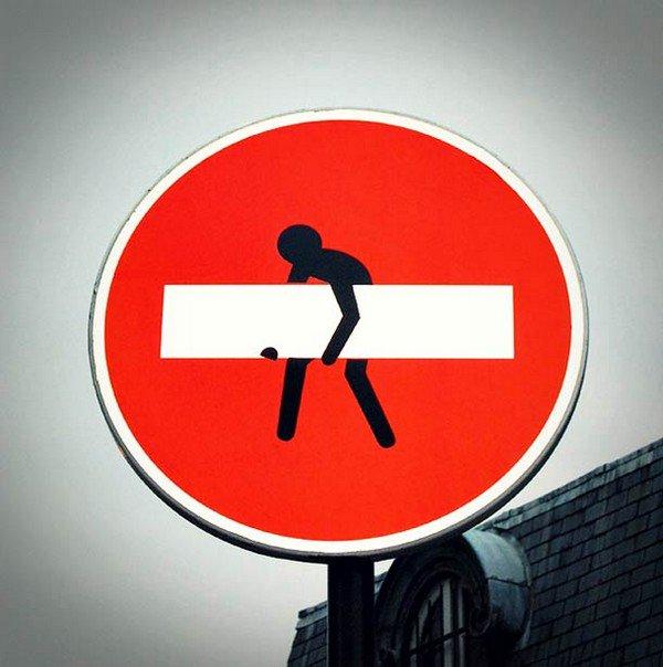 man lifting sign
