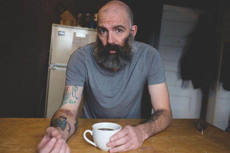 man showing tattoos