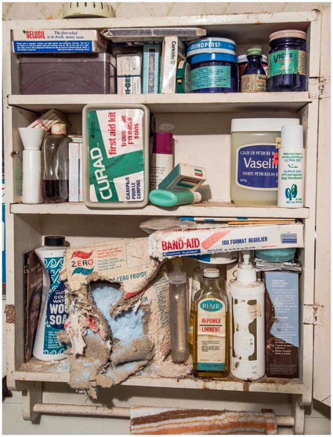 filled dilapidated medicine cabinet