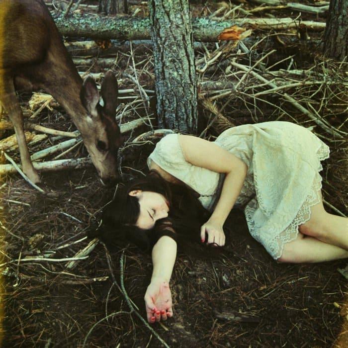 girl sleeping deer
