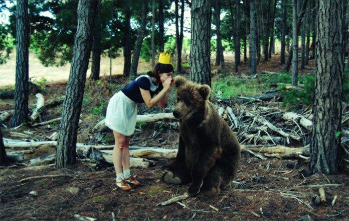 girl whispers bear
