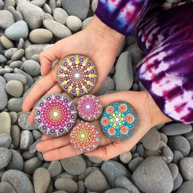 hands mandala stones