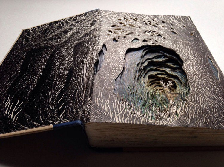 isobelle ouzman carved book