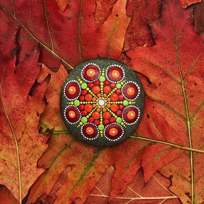 orange leaves mandala stone