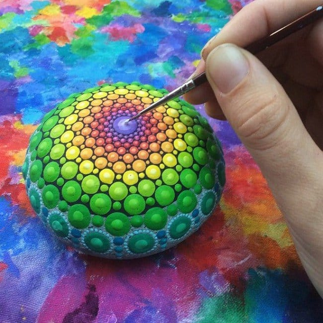 painting green mandala stone