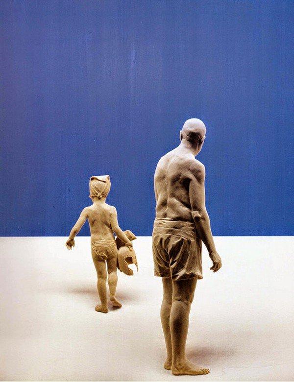 sculpture man child swimming