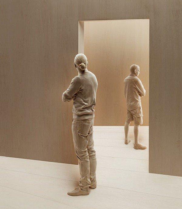 sculpture men doorway