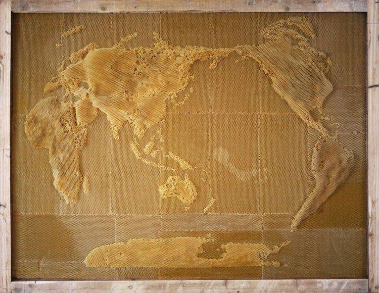 world map bee sculpture