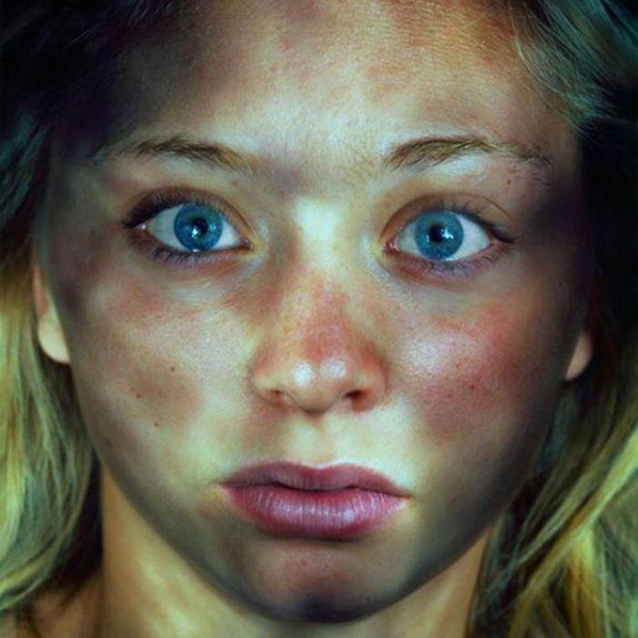 big blue eyes woman illuminated