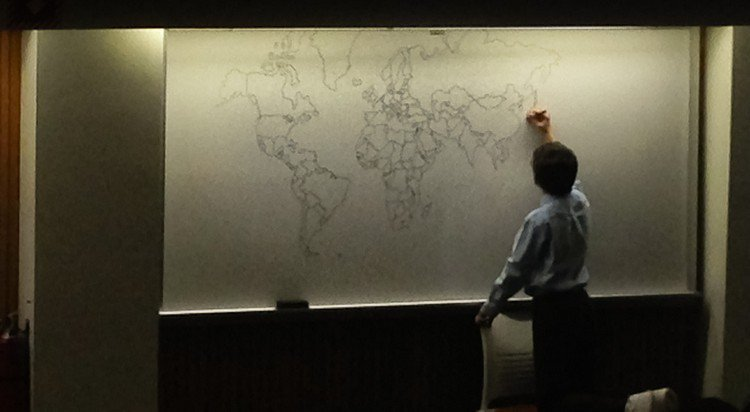boy drawing map