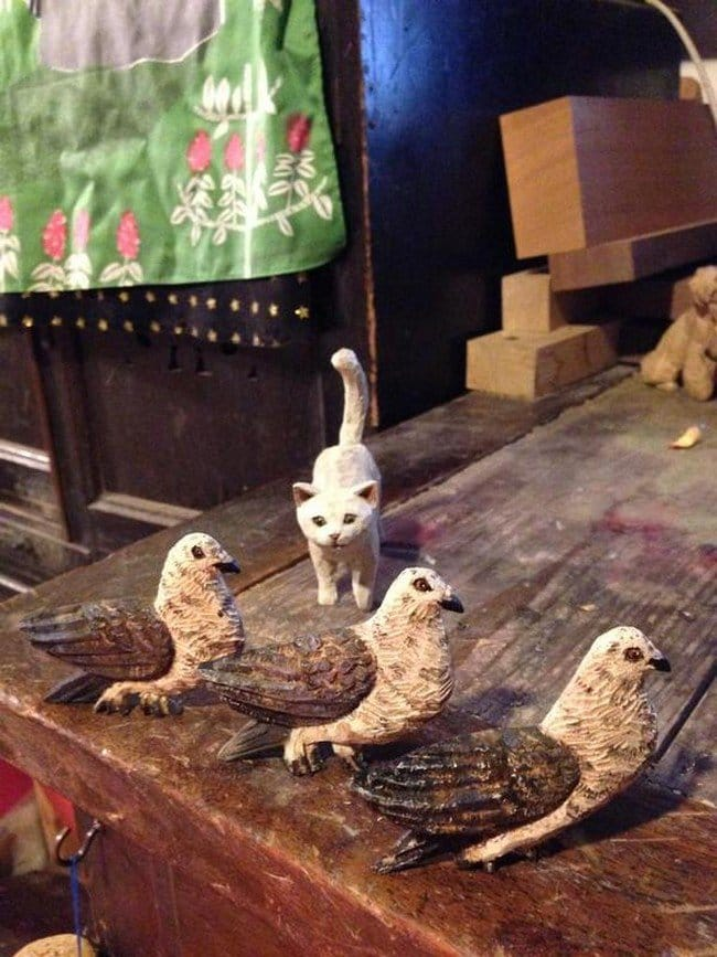 cat bird sculptures