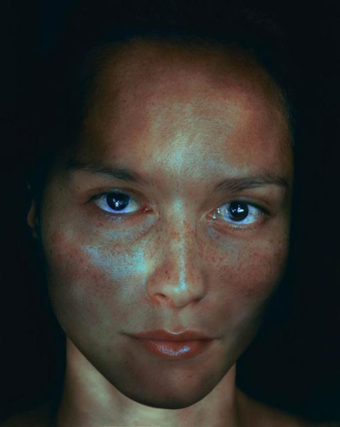 dark eyed woman illuminated