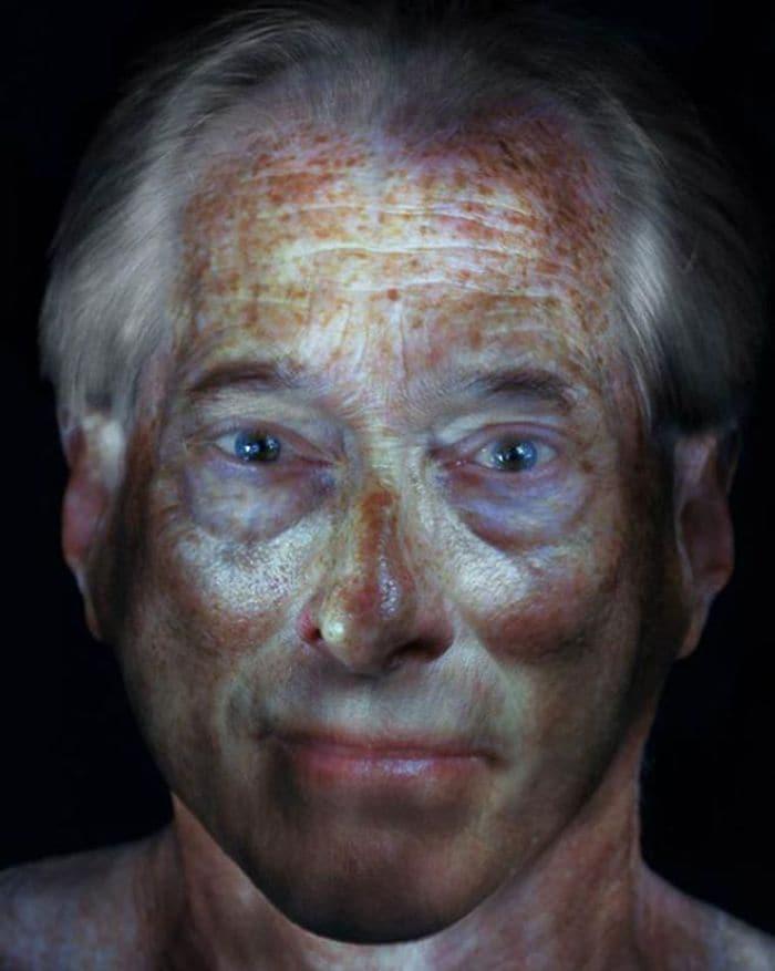 freckled man illuminated
