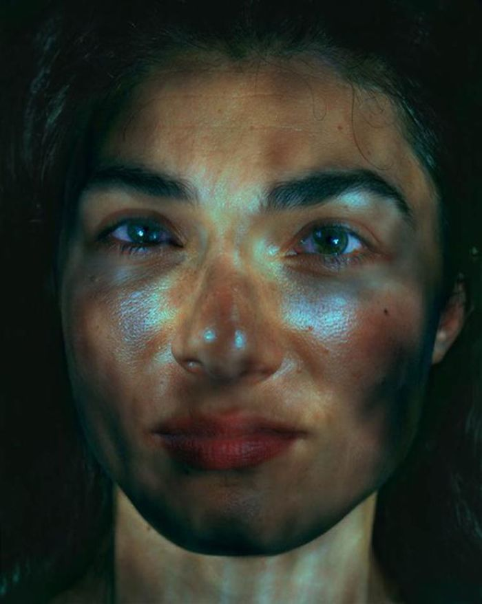 green eyed woman illuminated