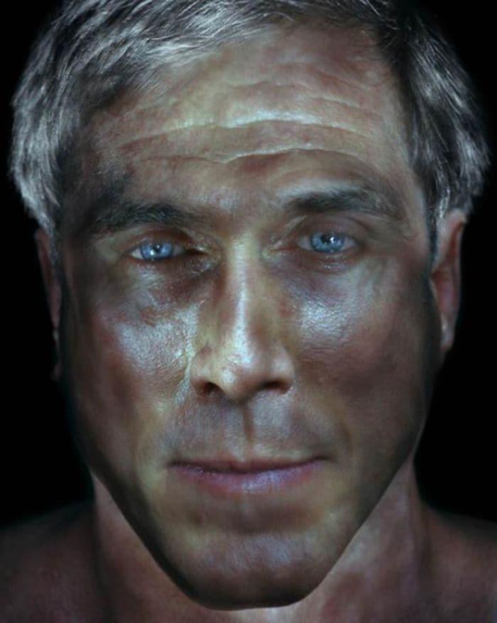 grey haired blue eyed man illuminated