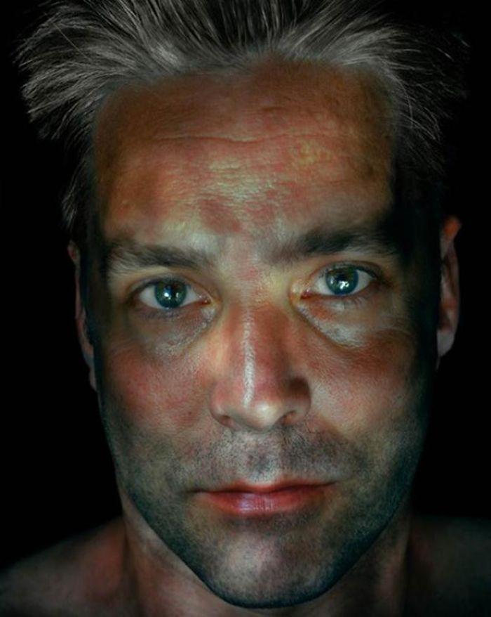 large eyed man illuminated