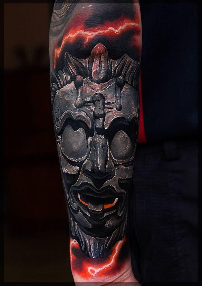 stone face tattoo