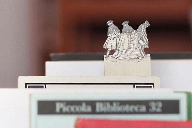 three men silver bookmark