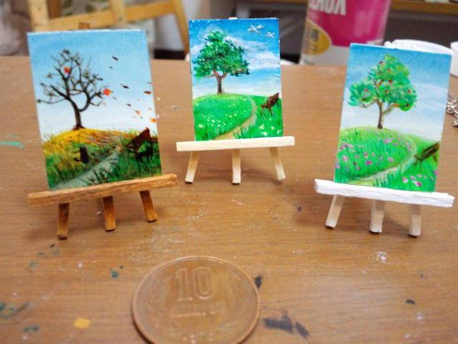 tiny canvases beside coin