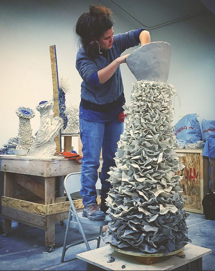 artist working sculpture