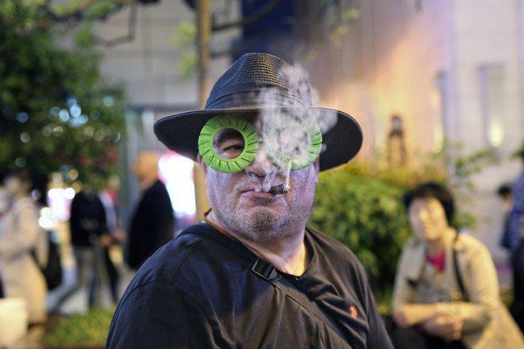 biz eyes eyewear man smoking