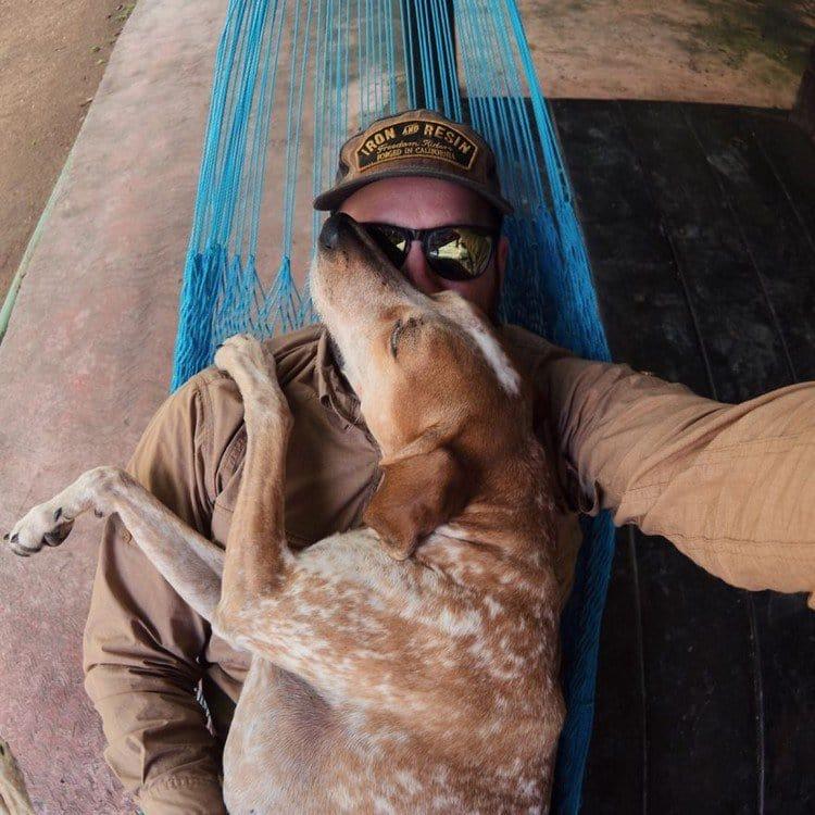dog hug man hammock