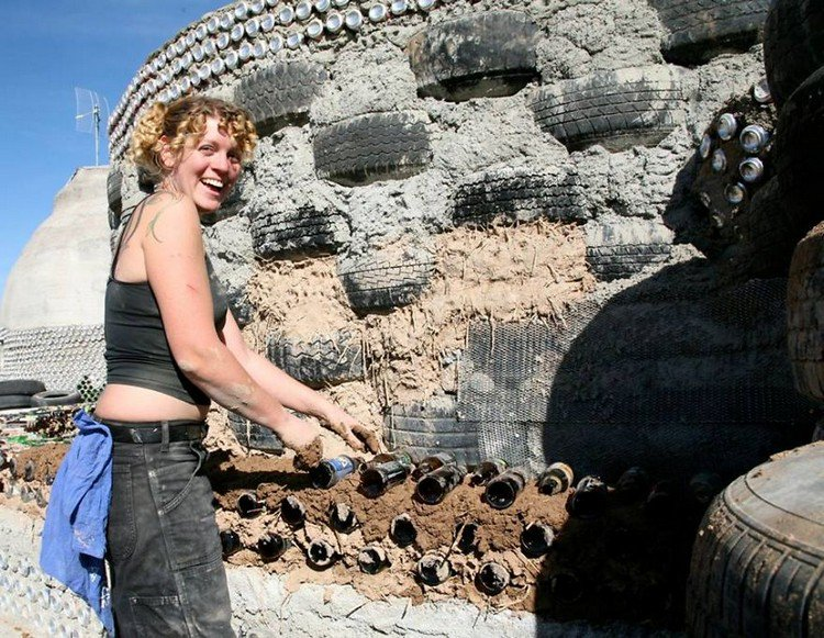 earthship construction smiling woman