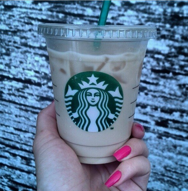 hand holding starbucks cup