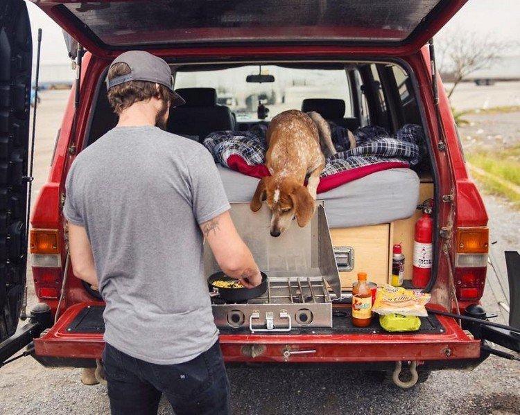man cooking dog vehicle