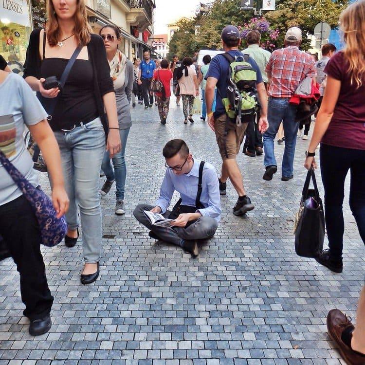 man reading floor crowd