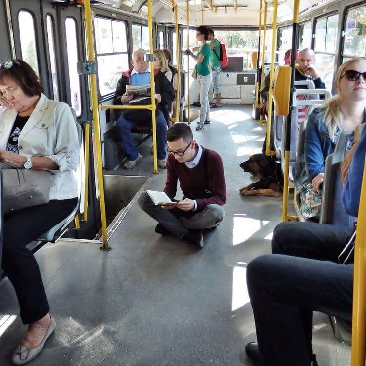 man reading public transport