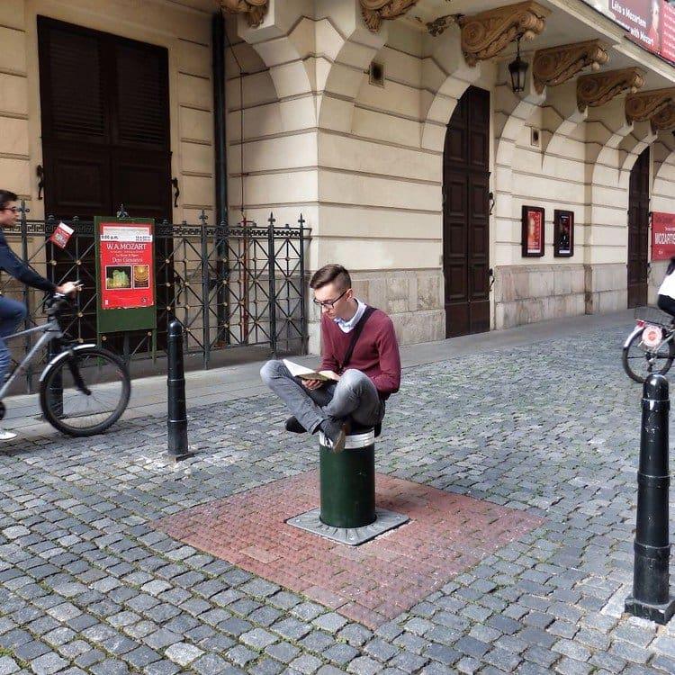 man reading public
