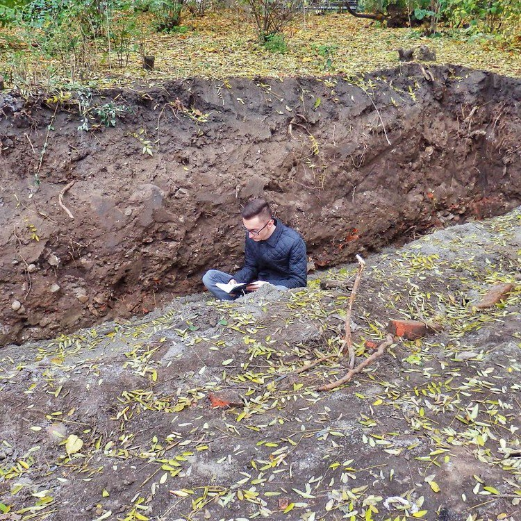 man reading trench