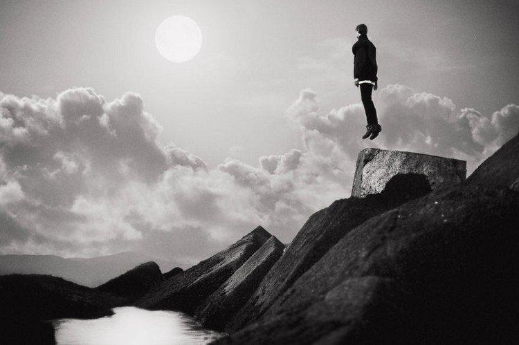 sun rocks man floating