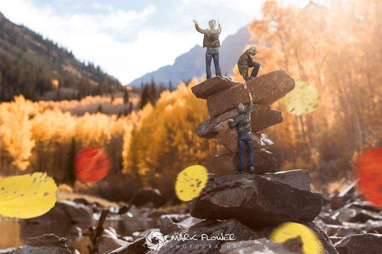 tiny men climbing stones
