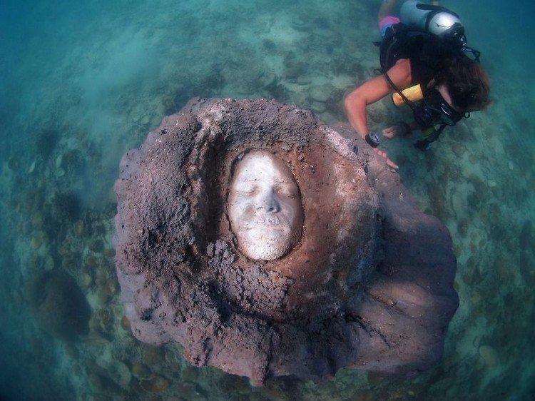 underwater sculpture face diver