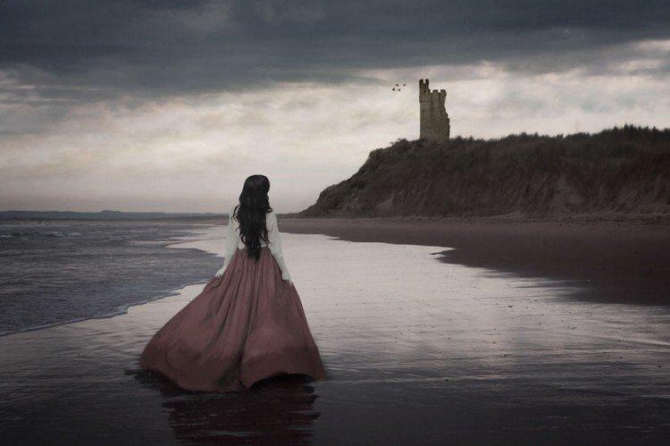 woman beach ruins