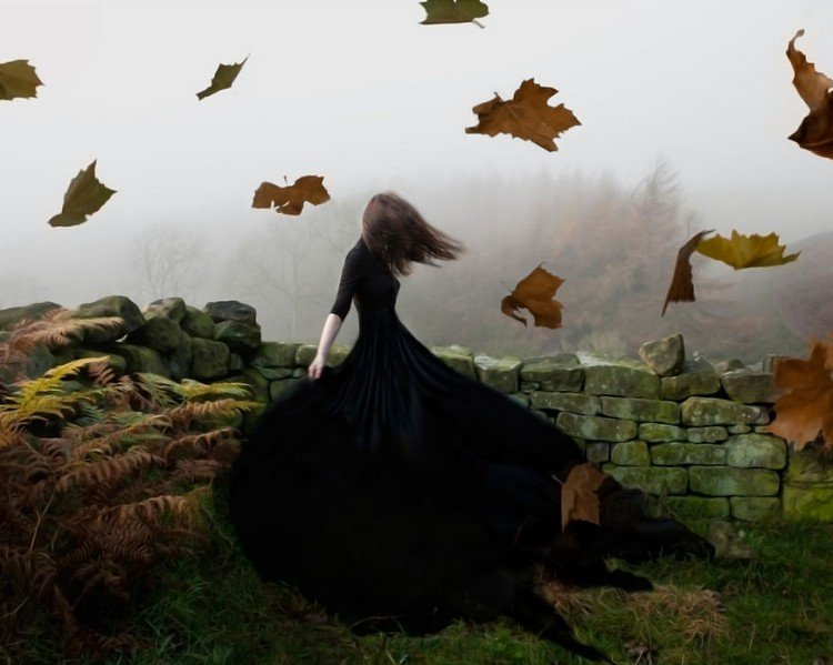 woman black dress falling leaves