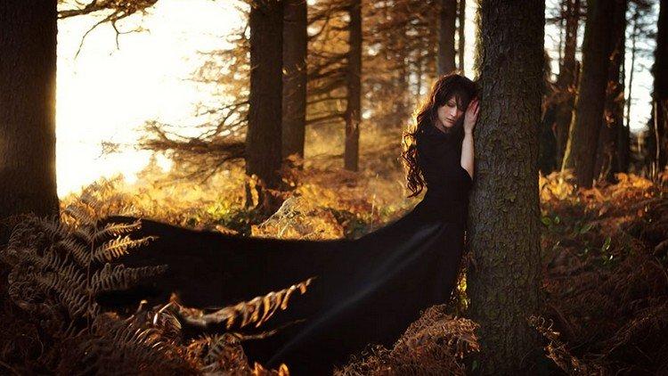 woman black dress tree