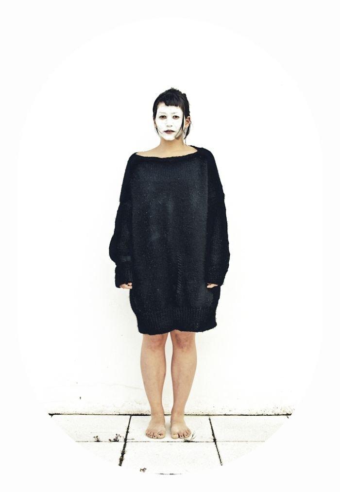 woman black hair white face