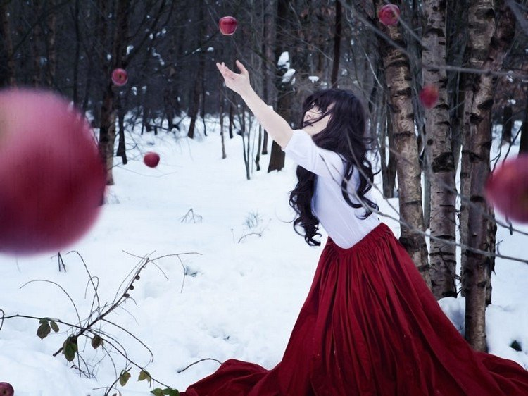 woman catching red apples