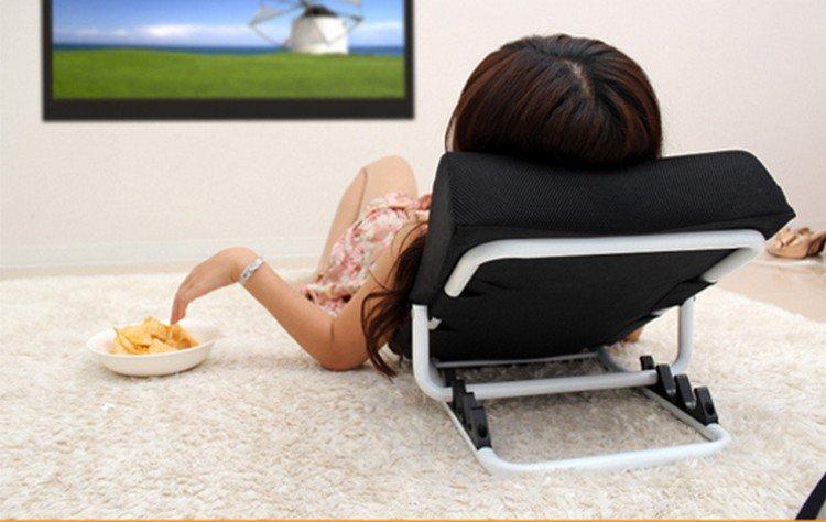 woman cushion watch tv