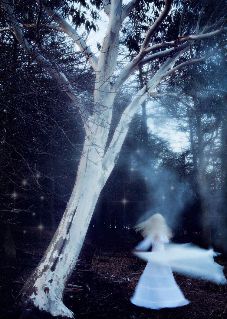 woman glowing stars tree