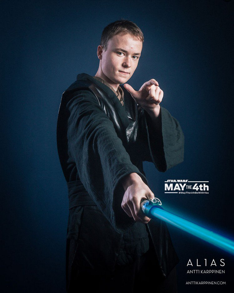 young man blue light saber
