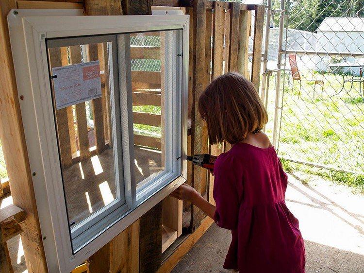 girl drilling window