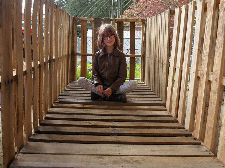 girl inside wooden structure