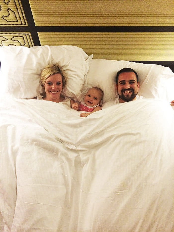 happy family bed smiling